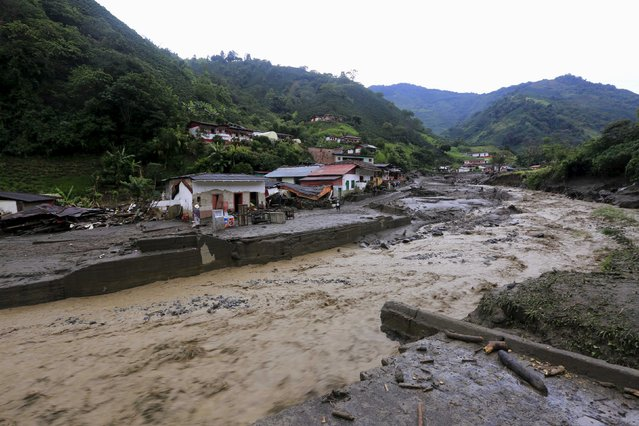 A general view of damaged homes by the La Liboriana river, after a landslide sent mud and water crashing onto homes close to the municipality of Salgar in Antioquia department, Colombia May 19, 2015. (Photo by Jose Miguel Gomez/Reuters)