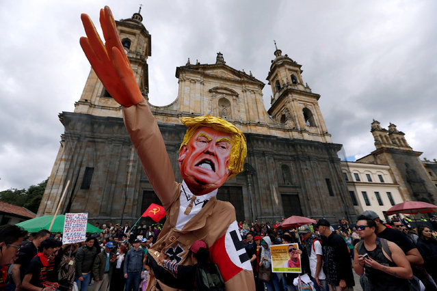 Protesters carry a cutout depicting U.S. President Donald Trump, wearing a Nazi uniform, during a rally commemorating May Day in Bogota, Colombia May 1, 2018. (Photo by Jaime Saldarriaga/Reuters)