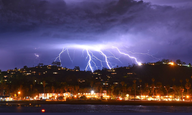 This time exposure photo provided by the Santa Barbara County Fire Department shows a series of lightning strikes over Santa Barbara, Calif., seen from Stearns Wharf in the city's harbor, Tuesday evening, March 5, 2019. A storm soaking California on Wednesday could trigger mudslides in wildfire burn areas where thousands of residents are under evacuation orders, authorities warned. The Santa Barbara County Sheriff's Office ordered 3,000 residents to evacuate hillside neighborhoods scarred by fires – including parts of Montecito hit by a disastrous debris flow just over a year ago. (Photo by Mike Eliason/Santa Barbara County Fire Department via AP Photo)