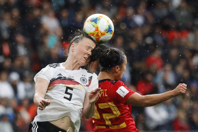 Germany's Marina Hegering, left, goes for a header with Spain's Nahikari Garcia during the Women's World Cup Group B soccer match between Spain and Germany at Stade du Hainau in Valenciennes, France, Wednesday, June 12, 2019. (Photo by Michel Spingler/AP Photo)
