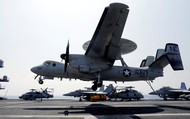 A U.S. Navy E-2C Hawkeye surveillance aircraft lands on the deck of aircraft carrier USS Carl Vinson during a FONOPS (Freedom of Navigation Operation Patrol) in South China Sea, March 3, 2017. (Photo by Erik De Castro/Reuters)