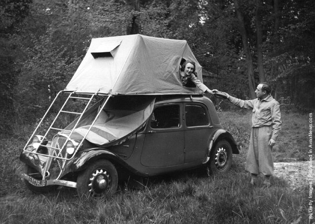 1950: A tent that balances very neatly on top a car