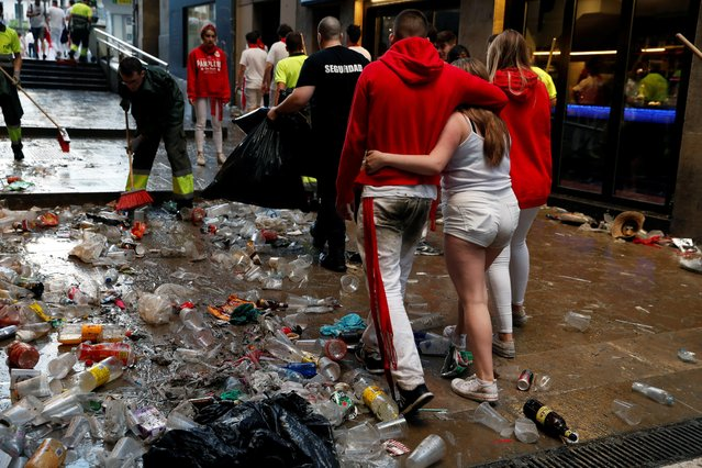 Revellers walks through trash before the second running of the bulls at the San Fermin festival in Pamplona, Spain, July 8, 2019. (Photo by Susana Vera/Reuters)
