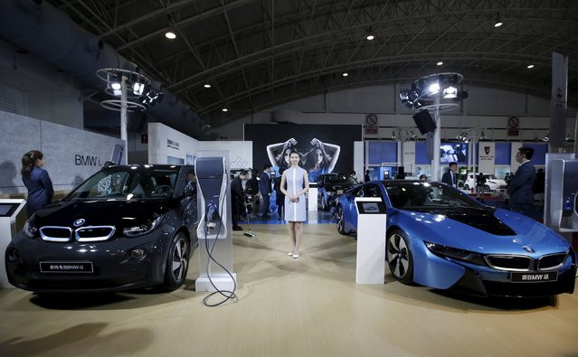A new BMW i8 plug-in hybrid sports car (R) and a new BMW i3 electric car are displayed during the Auto China 2016 in Beijing, China, April 25, 2016. (Photo by Jason Lee/Reuters)