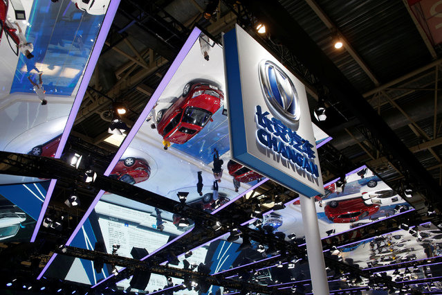 Changan Automobile Group's logo is pictured as its vehicles are reflected on a ceiling during the Auto China 2016 show in Beijing, China April 26, 2016. (Photo by Kim Kyung-Hoon/Reuters)