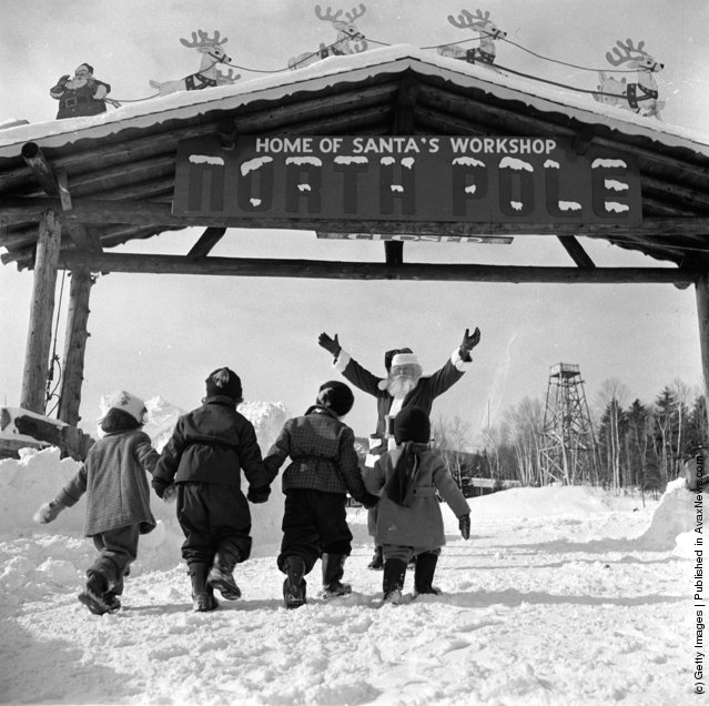1955: Santa Claus welcomes young visitors to his North Pole Workshop in the Adirondack Mountains of New York State