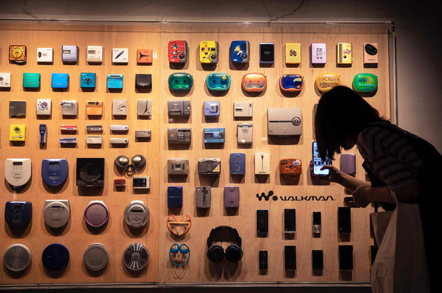 In this picture taken on July 10, 2019, various models of Sony Walkman audio players are displayed at an exhibition marking the 40th anniversary of the iconic device, in Tokyo. Must-have 80s gadget and one-time icon of Japan electronics cool, Sony's Walkman turned 40 this year and like its now middle-aged fans, is clinging to its youth with high-tech updates. (Photo by Behrouz Mehri/AFP Photo)