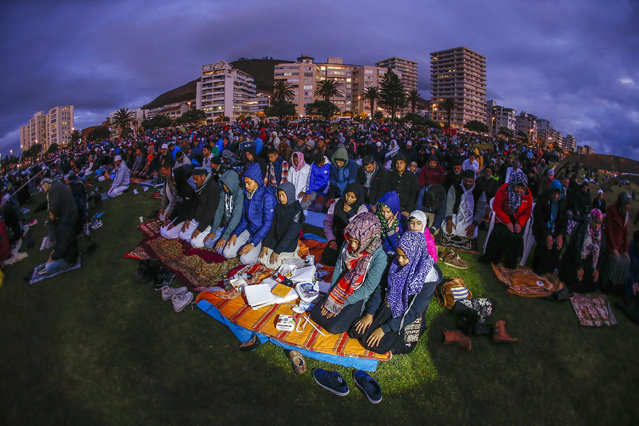 Muslims from South Africa pray during the siting of the moon gathering at the end of the Islamic holy month of Ramadan in Cape Town, South Africa, 16 June 2015. This marks the beginning of Eid al-Fitr, at the end of Ramadan, the holiest month in the Islamic calendar, during which Muslims around the world abstain from eating, drinking and sexual relations from sunrise to sunset. (Photo by Nic Bothma/EPA)