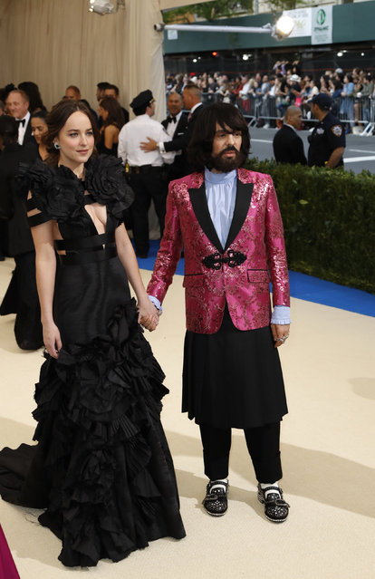 """Actress Dakota Johnson and Gucci creative director Alessandro Michele attend """"Rei Kawakubo/Comme des Garcons: Art Of The In-Between"""" Costume Institute Gala – Arrivals at Metropolitan Museum of Art on May 1, 2017 in New York City. (Photo by Lucas Jackson/Reuters)"""