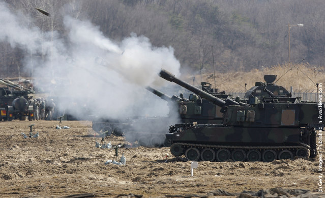U.S. soldiers from 145th Field Artillery Battalion deployed from the United States fire Paladin self propelled gun during the Foal Eagle training exercise at firing point 180 at the Rodriguez Live Fire Range