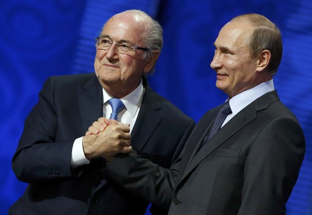 FIFA's President Sepp Blatter shakes hands with Russia's President Vladimir Putin (R) during the preliminary draw for the 2018 FIFA World Cup at Konstantin Palace in St. Petersburg, Russia July 25, 2015. (Photo by Grigory Dukor/Reuters)