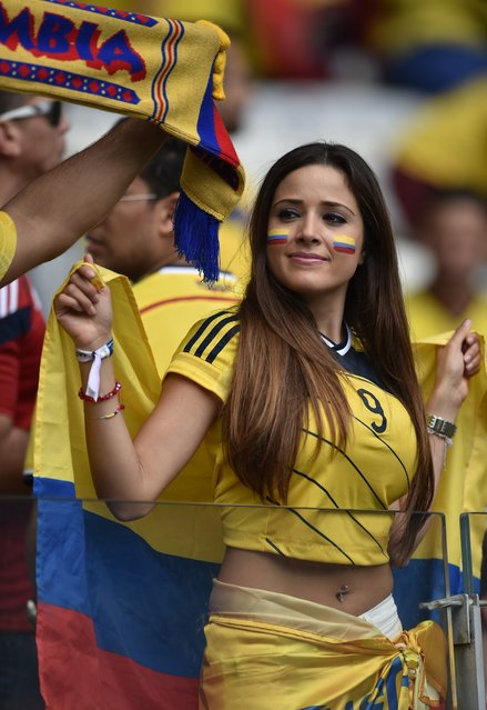 Colombia fans cheer before a Group C football match between Colombia and Greece at the Mineirao Arena in Belo Horizonte during the 2014 FIFA World Cup on June 14, 2014. (Photo by Aris Messinis/AFP Photo)