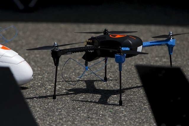 """An IRIS+ drone from 3D Robotics, referred to as """"Hawkeye"""", stands on the runway during """"Black Dart"""", a live-fly, live fire demonstration of 55 unmanned aerial vehicles, or drones, at Naval Base Ventura County Sea Range, Point Mugu, near Oxnard, California July 31, 2015. (Photo by Patrick T. Fallon/Reuters)"""