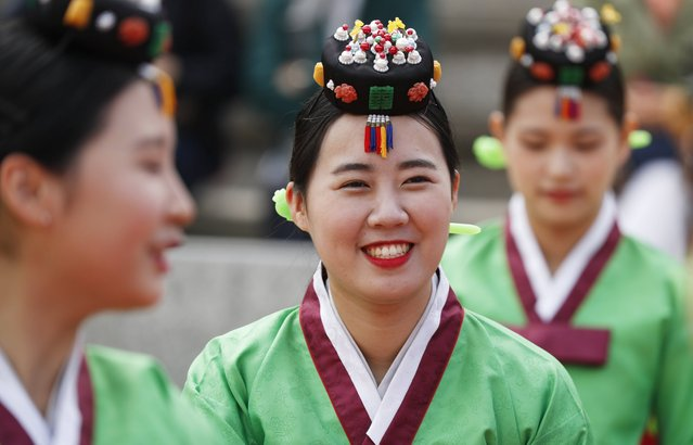 Twenty-year-old South Koreans wearing traditional costumes participate in the 45th Coming of Age Day ceremony at Namsangol Hanok Village in Seoul, South Korea, 15 May 2017. (Photo by Jeon Heon-Kyun/EPA)