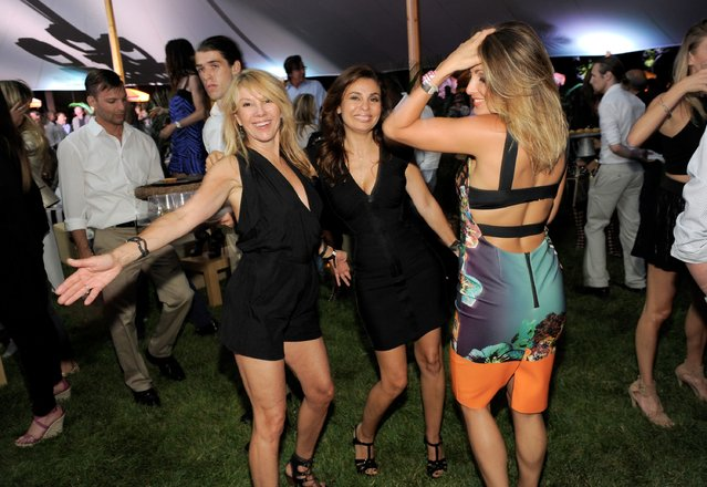 "Ramona Singer (L) and guests at VH1 Save The Music Foundation's ""Hamptons Live"" benefit hosted by Billy and Julie Macklowe at a private estate in Sagaponack, NY on August 8, 2015. (Photo by Matthew Eisman/Getty Images for Vh1 Save The Music)"