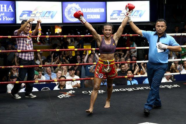 Muay Thai boxer Nong Rose Baan Charoensuk (C), who is transgender, reacts after winning a boxing match against Priewpak Sorjor Wichit-Padrew at the Rajadamnern Stadium in Bangkok, Thailand, July 13, 2017. (Photo by Athit Perawongmetha/Reuters)