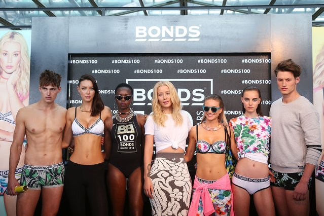 Iggy Azalea poses with models during Bonds 100th birthday celebration event at Cafe Sydney on August 19, 2015 in Sydney, Australia. (Photo by Brendon Thorne/Getty Images)