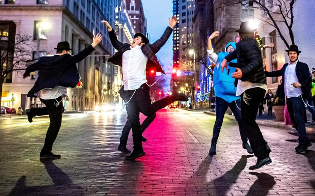 Yeshiva School students briefly dance on Grant Street after the menorah lighting outside of the City-County Building for the fifth night of Hanukkah, Thursday, December 26, 2019, in downtown Pittsburgh. (Photo by Alexandra Wimley/Pittsburgh Post-Gazette via AP Photo)