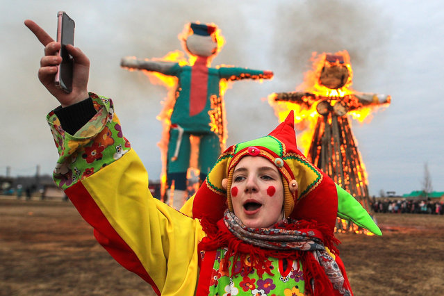 Burning effigies of winter during a celebration of Maslenitsa festival (Pancake Week) at the Etnomir (Ethnoworld) cultural and educational center in Kaluga Region, Russia on March 1, 2020. The holiday celebrates the end of winter and marks the arrival of spring. (Photo by Sergei Bobylev/TASS)