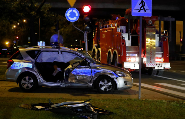 A police car, which is part of the motorcade transporting NATO General Secretary Jens Stoltenberg's delegation, is seen after an accident with a truck in Warsaw, Poland on August 24, 2017. (Photo by Kacper Pempel/Reuters)