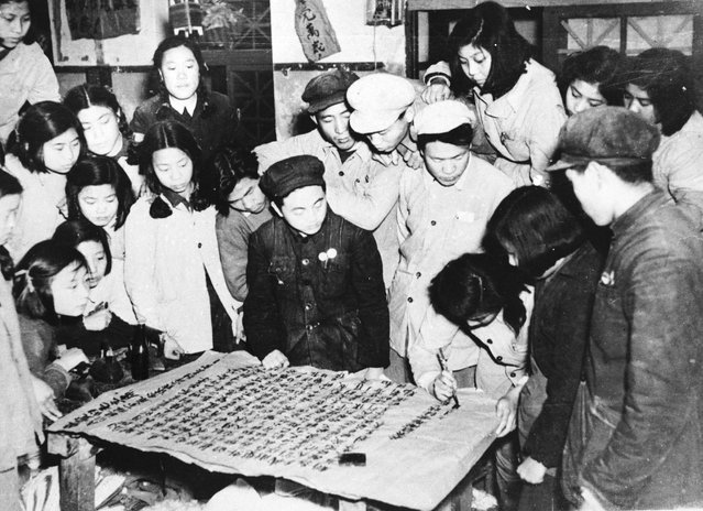 Workers in a Peking uniform and bedding factory writing a letter to Mao Tse Tung to express their determination to increase production following the intervention of the Communist Volunteers in the Korean War, December 1950. (Photo by Keystone)