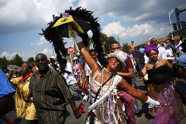 Marchers, including Jennifer Jones (C) mark the tenth anniversary of Hurricane Katrina by taking part in a remembrance and second-line parade through the Lower 9th Ward in New Orleans, Louisiana, August 29, 2015. (Photo by Edmund D. Fountain/Reuters)