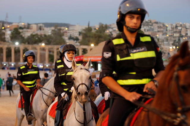 Jordanian police officers patrol during the Jerash Festival of Culture and Arts in the ancient city of Jerash, north of Amman, Jordan, July 26, 2016. (Photo by Muhammad Hamed/Reuters)
