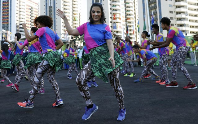 Dancers perform during the welcoming ceremony at the Olympic Village in Rio de Janeiro, Brazil August 1, 2016. (Photo by Kai Pfaffenbach/Reuters)