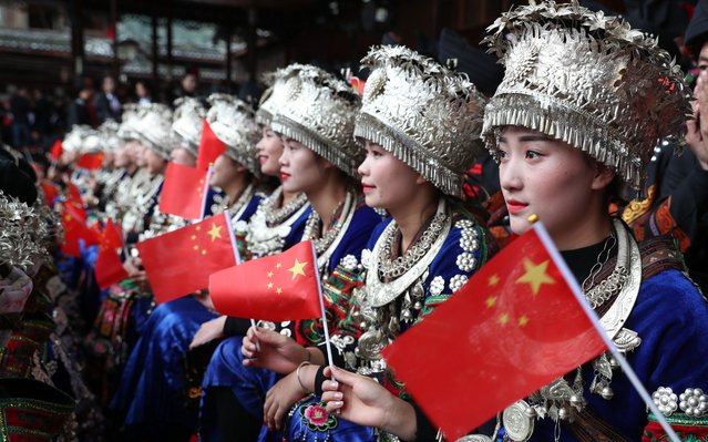 Miao people watch a live broadcast of the opening ceremony of the 19th National Congress of the Communist Party of China (CPC) at Leishan County on October 18, 2017 in Qiandongnan Miao and Dong Autonomous Prefecture, Guizhou Province of China. The Communist Party of China (CPC) opened the 19th National Congress at the Great Hall of the People in Beijing on Wednesday morning. (Photo by He Junyi/China News Service/VCG via Getty Images)