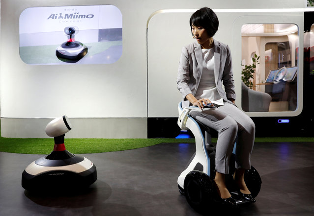 A model riding Honda ChairMobi Concept presents Ai-miimo, Honda's concept model of AI-installed lawn mower, during media preview of the 45th Tokyo Motor Show, Japan on October 25, 2017. (Photo by Kim Kyung-Hoon/Reuters)