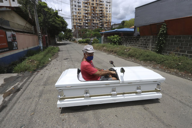 Gabriel Berendo, a businessman and car enthusiast, drives a casket converted into a car on Sunday May 31, 2020 in Cebu city, central Philippines as he goes around streets to remind residents to stay at home as lockdown measures to prevent the spread of the new coronavirus eases next week. (Photo by AP Photo/Stringer)