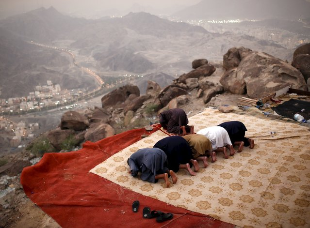 Muslim pilgrims pray atop Mount Thor in the holy city of Mecca ahead of the annual haj pilgrimage September 19, 2015. (Photo by Ahmad Masood/Reuters)