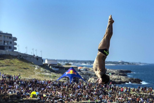 Alessandro De Rose of Italy dives from the 27 metre platform during the first competition day of the fifth stop of the Red Bull Cliff Diving World Series in Polignano a Mare, Italy on August 27, 2016. (Photo by Dean Treml/ANSA/Red Bull Press Office)