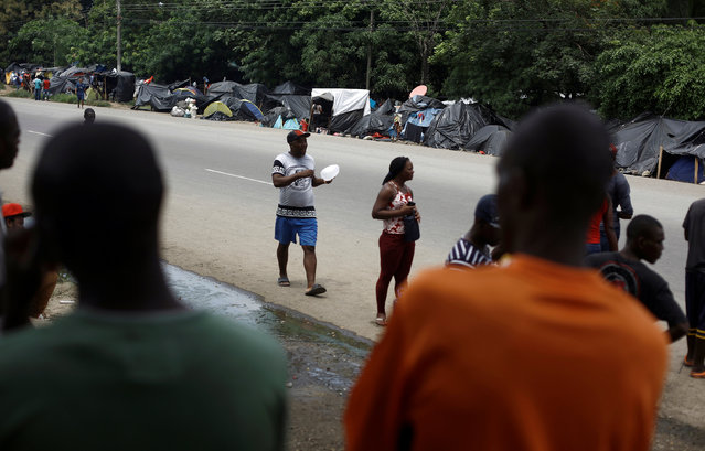African migrants stranded in Costa Rica stand at a makeshift camp on the edge of the Inter-American Highway at the border between Costa Rica and Nicaragua, in Penas Blancas, Costa Rica,  September 8, 2016. (Photo by Juan Carlos Ulate/Reuters)