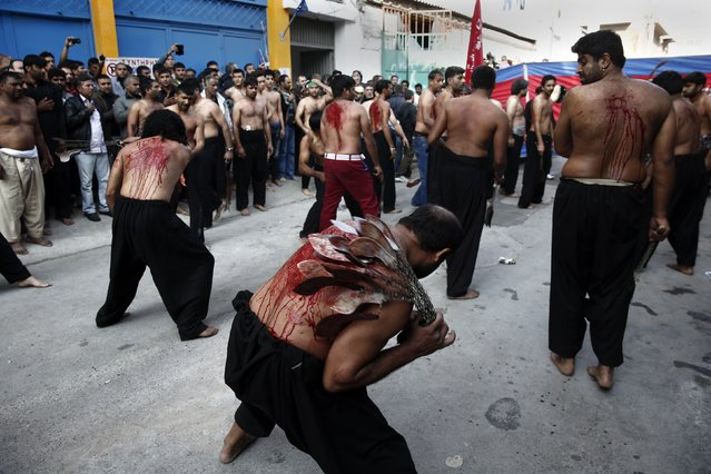 Shi'ite Muslims flagellate themselves during a Muharram procession marking Ashoura in Piraeus port town, near Athens November 4, 2014. Ashoura, which falls on the 10th day of the Islamic month of Muharram, commemorates the death of Imam Hussein, grandson of Prophet Mohammad, who was killed in the seventh century battle of Kerbala. (Photo by Yorgos Karahalis/Reuters)