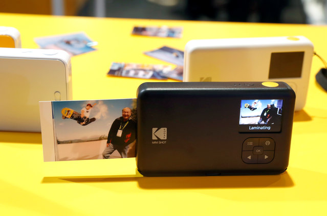 A photo comes out of the KODAK Mini Shot Instant Camera during the 2018 CES in Las Vegas, Nevada, U.S. January 10, 2018. (Photo by Steve Marcus/Reuters)