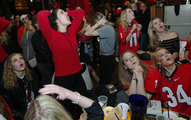 Georgia fans reacts to Georgia's loss while watching the College Football Playoff national championship football game against Alabama in Athens, Ga., Monday, January 8, 2018. Alabama won, 26-23. (Photo by Tami Chappell/AP Photo)