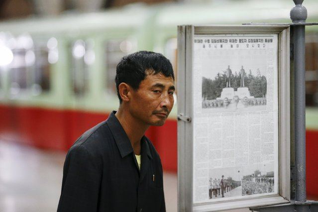 A man reads newspapers displayed inside a subway station visited by foreign reporters during a government organised tour in Pyongyang, North Korea October 9, 2015. (Photo by Damir Sagolj/Reuters)
