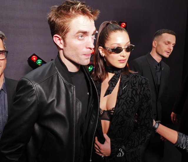 Actor Robert Pattinson and model Bella Hadid attend the Dior Homme Menswear Fall/Winter 2018-2019 show as part of Paris Fashion Week on January 20, 2018 in Paris, France. (Photo by Swan Gallet/WWD/Rex Features/Shutterstock)