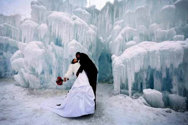 Brandon and Natasha Green, of Minneapolis, give each other a smooch after a ceremony during which eleven couples were married in a ceremony at the Mall of America Ice Castle in Bloomington, Minnesota, on February 14, 2013. (Photo by Brian Peterson/Minneapolis Star Tribune/MCT)