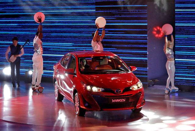 A Toyota Yaris sedan car is driven onto the stage during its launch at the India Auto Show 2018 in Greater Noida,  February 7, 2018. (Photo by Saumya Khandelwal/Reuters)