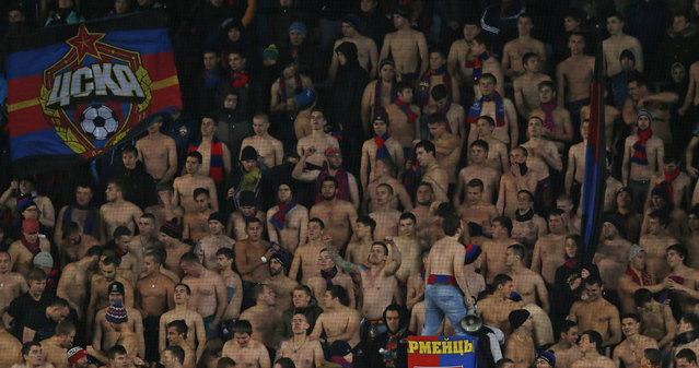 Football, CSKA Moscow vs Manchester United, UEFA Champions League Group Stage, Group B, Arena Khimki, Khimki, Moscow, Russia on October 21, 2015: CSKA Moscow fans take off their shirts in the stands. (Photo by Andrew Boyers/Reuters/Action Images)