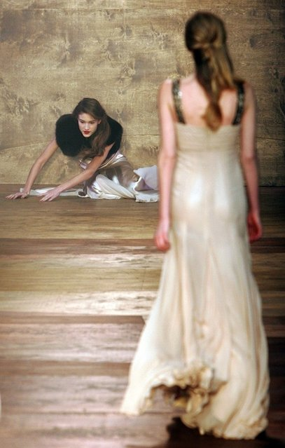 A model falls as she wears a creation by designer Amanda Wakeley at her autumn/winter 2006 show during London Fashion Week in London February 14, 2006. (Photo by Stephen Hird/Reuters)