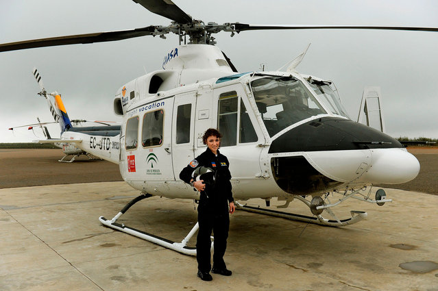 Carla Rozalen, 29 years old, helicopter pilot poses for a picture in front of a Bell 412 twin-engine utility helicopter at the FAASA Group, in Palma del Rio, Cordoba on February 27, 2018. (Photo by Cristina Quicler/AFP Photo)
