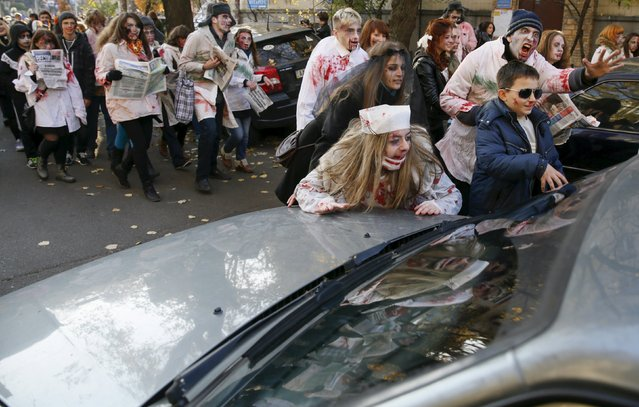 Revellers dressed as zombies march during a Halloween event in Kiev, Ukraine, October 31, 2015. (Photo by Valentyn Ogirenko/Reuters)