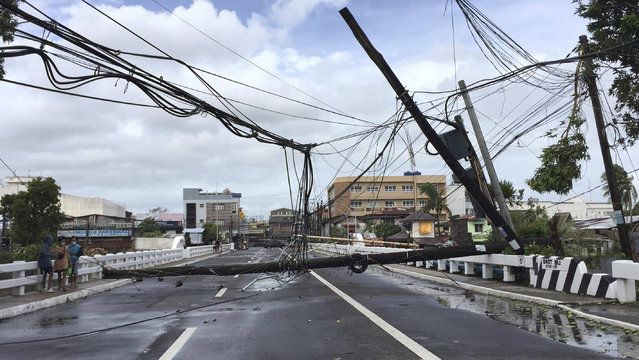 Electrical poles are toppled due to strong winds from Typhoon Goni in Daet, Camarines Norte province, central Philippines, Sunday November 1, 2020. The super typhoon slammed into the eastern Philippines with ferocious winds early Sunday and about a million people have been evacuated in its projected path, including in the capital where the main international airport was ordered closed. (Photo by Sharalaine Robles Gonzales/AP Photo)