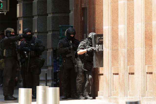 Armed policeman are seen outside Lindt Cafe on Philip St, Martin Place on December 15, 2014 in Sydney, Australia.  Police attend a hostage situation at Lindt Cafe in Martin Place. (Photo by Mark Metcalfe/Getty Images)