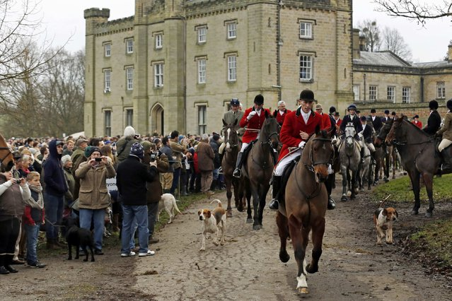 Members of the Old Surrey Burstow and West Kent Hunt leave Chiddingstone Castle for the annual Boxing Day hunt in Chiddingstone, south east England December 26, 2014. (Photo by Luke MacGregor/Reuters)