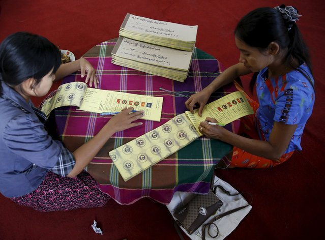 Women label ballots at a polling station ahead of tomorrow's general election in Mandalay, Myanmar, November 7, 2015. Myanmar on November 8 is holding its first free and fair election in 25 years in which democracy icon Aung San Suu Kyi is pitted against the ruling party comprised of former members of a military junta. (Photo by Olivia Harris/Reuters)