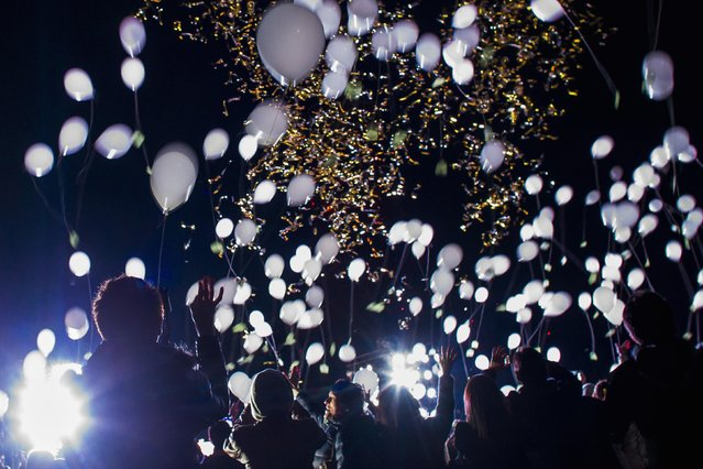People release balloons during New Year celebrations in Tokyo January 1, 2015. (Photo by Thomas Peter/Reuters)